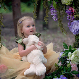 wonder by Carole Brown - Babies & Children Child Portraits ( blonde hair, floral swing, blue eyes, stuffed lamb, 2 year old girl )