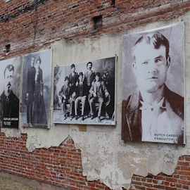 Wall Mural On Old Brick by Mike Logan - Buildings & Architecture Other Exteriors ( brick and plaster, panguitch utah, brick, mural, butch cassidy )