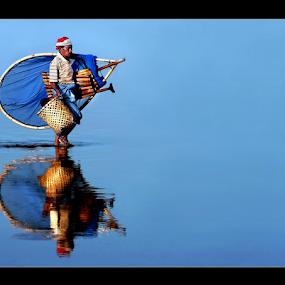 CrossInG tHe LaKe by Irwan Karim - People Street & Candids ( walking, reflection, colors, reflections, object, landscape, limboto lake, gorontalo, portrait, mirror, danau limboto, color, filter forge, fisherman )