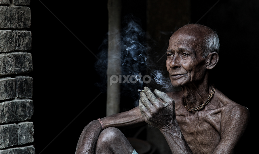 by Souvik Goswami - People Portraits of Men ( smoking, biri, wisp of wisdom, senior citizen, aged )