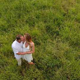 Above the Grass by Andrew Morgan - Wedding Bride & Groom ( love, colour, kiss, grass, happy, joy, wedding, green )
