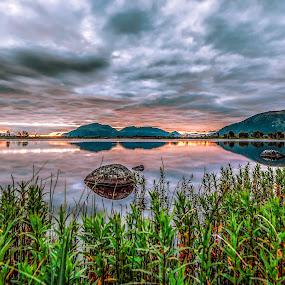 Sunset pond by Benny Høynes - Landscapes Sunsets & Sunrises ( hill, colourful, grass, sunset, lake, rocks, pond, colours,  )