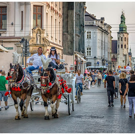 Easy does it by Lani Edwards - City,  Street & Park  Street Scenes ( krakow, central europe, transportation, people, poland )