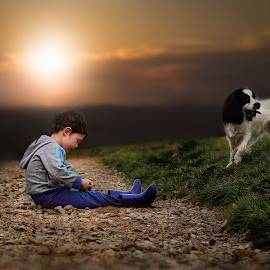 A Time To Think by Una Williams Photos - Babies & Children Children Candids ( grass, sunset, stones, dog, boy )