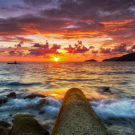 Sunset by BRYON PHILIP - Landscapes Sunsets & Sunrises ( clouds, seashore, seascapes, sunset, clouds and sea, cloud, sea, rock, seascape, seaside, sunlight, rocks, sea shore )
