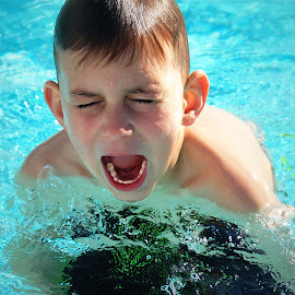 Young Boy In Pool With Eyes Closed And Mouth Open by Robin Amaral - Babies & Children Children Candids ( excitement, water, face, splash, joy, mouth, child photography, close up, teeth, swimming, shadows, child, child candid, pool, childhood, boy )