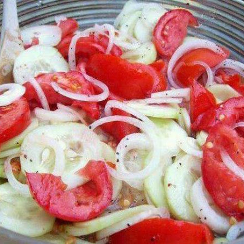 Marinated Cucumbers, onions and tomatoes
