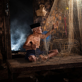 Jakarta's Old Traditional Fisherman  by Aloysius Alphonso - People Street & Candids