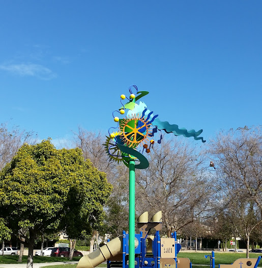 The whimsical design and citrus theme of this kinetic work by Nancy Mooslin complements the surrounding neighborhood park and the Ventura, California community's citrus heritage.