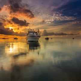 Getting High by Choky Ochtavian Watulingas - Landscapes Sunsets & Sunrises ( clouds, reflection, boats, reflections, seascape, sunrise )