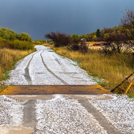 Cattle Guard after the Hail by Chad Roberts - Landscapes Prairies, Meadows & Fields ( idaho, hail, cattle guard, wyoming, tracks, road, grand tetons, hailstorm )