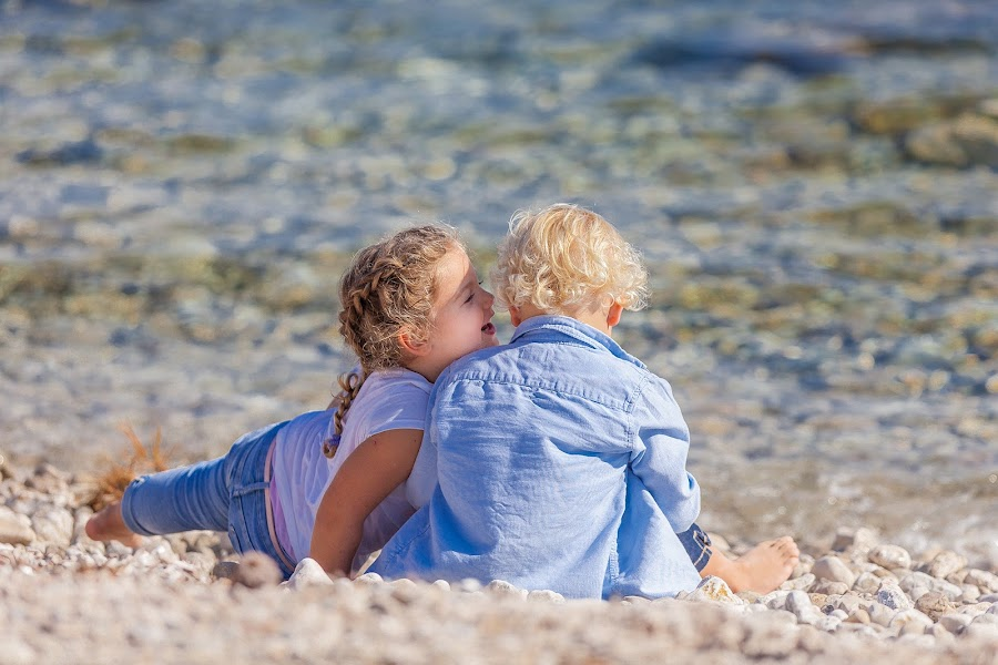 Happy Kids by Gregor Grega - Babies & Children Children Candids ( love, blonde, eternal love, blue, chatting, lovely, sea, happiness, beauty, beach, kids, cute, stones, smiling,  )