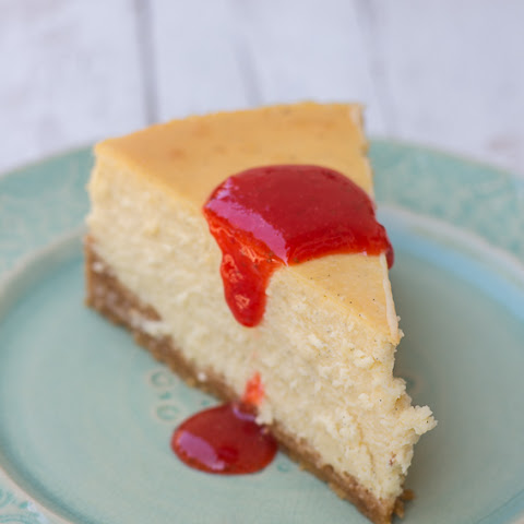 Vanilla Bean Cheesecake with Strawberry Sauce