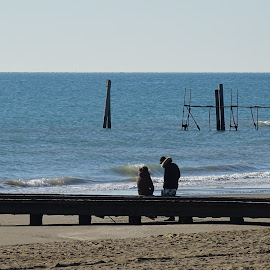Young couple at sea in winter by Patrizia Emiliani - People Couples ( winter, sea, couple )