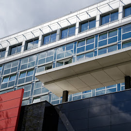 Modern Office Building in Cologne by Johannes Oehl - Buildings & Architecture Architectural Detail ( cologne, europe, north rhine-westphalia, architecture, creative image, business, modern, daytime, color image, exterior view, sunny, grid, germany, office, dark-gray, building, cardinal, architecture-photography, architectural detail, altocumulus cloud, fair weather, new, red, window, blue, elegant, contemporary, outdoors, diagonal lines, company, nordrhein-westfalen, framed window, lines, sun light, window glass, steelblue, design, outside, low angle view )