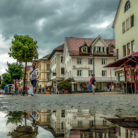 Paddle! by Jesus Giraldo - City,  Street & Park  Street Scenes ( water, reflection, concept, street, art, city, urban, tree, buildings, homes, walk, paddle, man )
