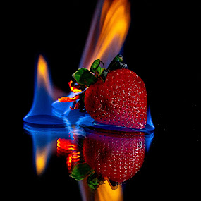 Strawberry Flambe 2 by SumPics Photography - Food & Drink Fruits & Vegetables ( orange, reflection, warm, leaf, strawberry, fire, flame, black background, red, blue, stem, black, flambe )