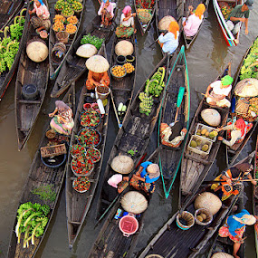 by Sofian Anwar - News & Events World Events ( market, boat, river )