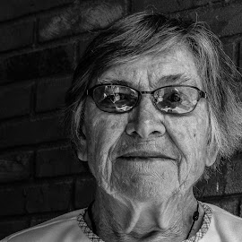 Reflection of Wisdom by Anthony Mara - People Portraits of Women ( wrinkles, glasses, black and white, brick, woman, age, reflections, wall,  )