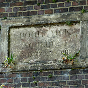 POOL LOCK AQUEDUCT MDCCCXXVIIII This is on the side of the aqueduct (built in 1829) carrying the Macclesfield Canal across the Trent and Mersey Canal a few metres north-west of the paired locks (No ...