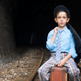 Child in vintage clothes sits on railway road by Deyan Georgiev - Transportation Trains ( person, sadness, one, way, little, travel, transportation, wait, caucasian, kid, child, girl, nature, rail, train, trip, childhood, platform, vintage, station, suitcase, track, traveler, young, vacation, sitting, railway, background, outdoors, tired, case, boy )
