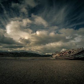 Dulas Wreck by Peter Rollings - Landscapes Beaches ( clouds, vessel, sky, bay, dulas, wreck, dramatic, derelict, shingle, beach, boat, abandoned,  )