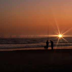 Gone Fishing by Danette de Klerk - Landscapes Beaches ( waves, sand, ocean, fishing, sunset, beach, water, fisherman, silhouettes )