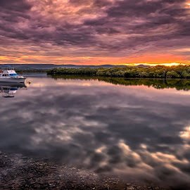 Streaky Skies by Alex Stecina - Landscapes Waterscapes ( clouds, water, reflections, drama, boat, dusk, fire, coast, sky, sunset, dramatic, long exposure, light, river )
