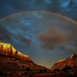 Rainbow over San Rafael Swell Utah by Bernt Nielsen - Landscapes Deserts