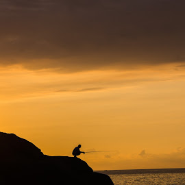 Fishing at the shore by Duc Truc Nguyen - Uncategorized All Uncategorized ( shore, fish, sea, fishing, morning, sihouette, black, coast, man )