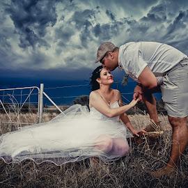 Stormy Love by Jolene Groenewald - Wedding Bride & Groom ( wedding photography, farmland, lovebirds, storm, kisses )