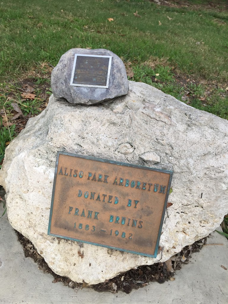 Aliso Park Arboretum  Donated by Frank Bruins 1883 - 1982   Smaller marker is new as of December 30, 2016.  Text is difficult to read:  In loving memory of Ben
