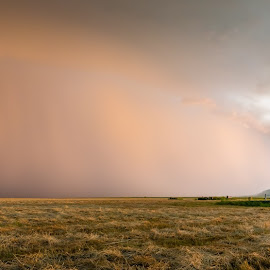 by Kendra Perry Koski - Landscapes Weather ( gray sky, lightning, meade county, barn, thunderstorm, blue, grass, sunset, hay, summer, july, hay bale, landscape, storm )