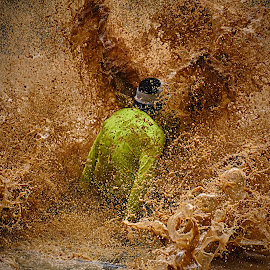 Splaaassshhhh ! by Marco Bertamé - Sports & Fitness Other Sports ( water, muddy, sliding, differdange, splatter, splash, strong, 2015, brown, yellow, soup, strongmanrun, man, luxembourg )