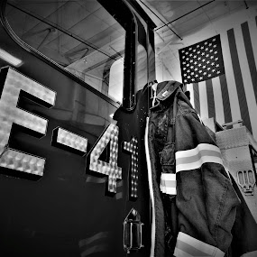 Always at the Ready by Travis Wessel - Black & White Objects & Still Life ( firefighter, american flag, firefighters, apparatus, emergency, firetruck, fire house, united states, firefighter gear, fire department )