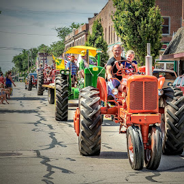 Tractor Parade by T Sco - City,  Street & Park  Street Scenes ( small town, town, road, street, truck, tractor, rural, downtown, uptown, folks, transportation )