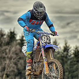 Flying Blue Man by Marco Bertamé - Sports & Fitness Motorsports ( flying, motocross, speed, blue, 92, air, number, race, noise, jump )