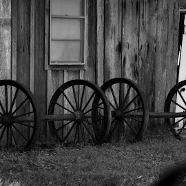 Old building and wagon wheels by Brenda Shoemake - Buildings & Architecture Other Exteriors