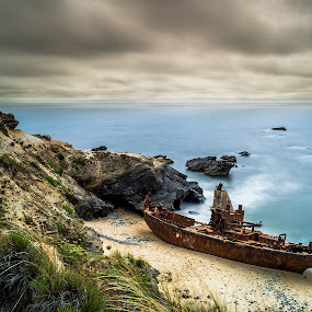Pirate boat ? by Emanuel Fernandes - Landscapes Waterscapes ( water, clouds, old, sky, long, boat, portugal, rocks )