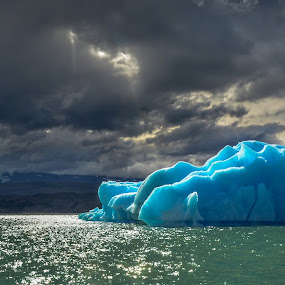 At the end of the world, where living glaciers ... by Haim Rosenfeld - Landscapes Waterscapes ( iceberg, dreamy, seasonal, mystery, santa cruz, drama, contemplate, contrast, unreal, sky, nature, cold, el calafate, surreal, place, light, dream, patagonia, texture, colors, mood, soul, atmosphere, image, lake, glacier, picture, season, scene, view, natural, exposure, waterscape, beauty, sun, argentina, mountains, ice, dreamlike, dramatic, upsala, nikon, water, clouds, green, beautiful, sea, scenic, photo, great, red, blue, color, background, beam, scenery )