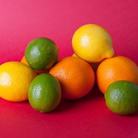 Limes_oranges_lemon_stock_pictures by Brian Ib Nielsen - Food & Drink Fruits & Vegetables ( raw, juicy, lemons, coloured, mandarin, yellow, colour, fresh, juice, glass, mixed, orange, bowl, fruit, green, fruits, backgrounds, lime, oranges, limes, health, colours, red, citrus, food, kumquats, background, healthy, grapefruit, lemon )