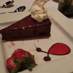GF flourless torte with raspberry coulis
