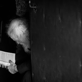 monk reading Bible in cave monasteries by Ioan Pan - People Portraits of Men ( reading, monk, monastery, bible, cave, man, portrait )