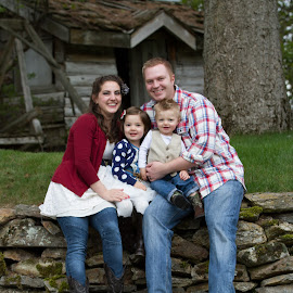 Family on the rocks by Craig Lybbert - People Family ( dad, girl, family, toddler, rocks, mom )