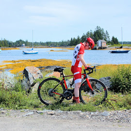 Ready to Ride by Lena Arkell - Sports & Fitness Cycling ( red, blue sky, atlantic, bicycle, ocean, canada, nova scotia, boat,  )
