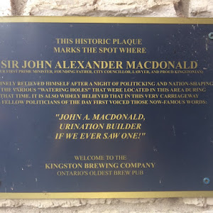 THIS HISTORIC PLAQUE MARKS THE SPOT WHERE SIR JOHN ALEXANDER MACDONALD (OUR FIRST PRIME MINISTER, FOUNDING FATHER, CITY COUNCILLOR, LAWYER. AND PROUD KINGSTONIAN) ROUTINELY RELIEVED HIMSELF AFTER A ...