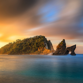 The Icon by Rio Tanusudiro - Landscapes Sunsets & Sunrises ( clouds, water, smooth, rock, seascape, beach, travel, morning, color, long exposure, sunrise, motion, light )