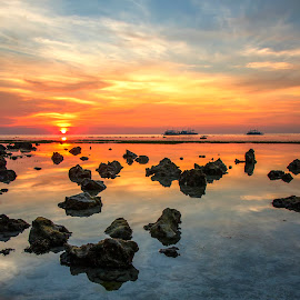 Tranquil by Geoffrey Wols - Landscapes Sunsets & Sunrises ( sunrise, colour, malapascua island, rocks, reflections, sunset, philippines, water,  )