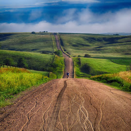 Just peddlin' along by Ryan Trullinger - Landscapes Prairies, Meadows & Fields ( clouds, hills, gravel, roads, bicycle )