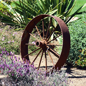 The Wagon Wheel by Derrick DeCorte - Artistic Objects Antiques ( garden sculpture, pioneer., wagon wheel, 1800's, western, antique )